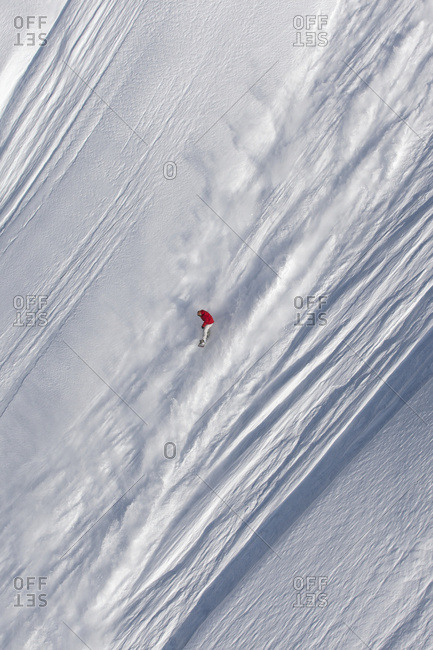 Extreme Snowboarding On A Snow Covered Slope; Haines, Alaska, United States Of America