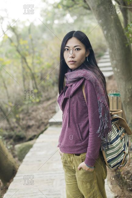 Portrait Of A Female Model On A Wooden Boardwalk; Xiamen, China