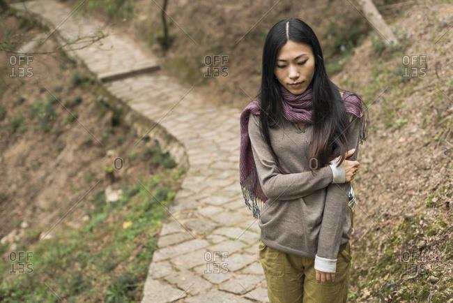 Young Woman Walking On A Trail; Xiamen, China