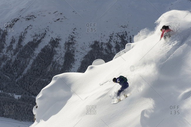 Snowboarding In Powder Snow; St. Moritz, Graubunden, Switzerland