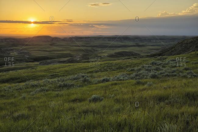 Sunset Over Killdeer Badlands In Grasslands National Park; Saskatchewan, Canada