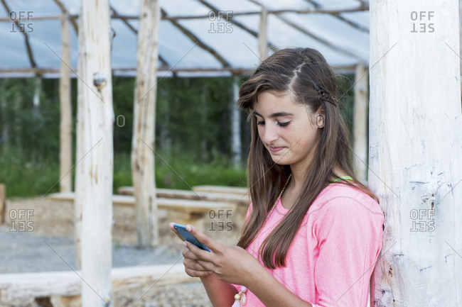 Teenage Girl Texting On An Electronic Device; Palmer, Alaska, United States Of America