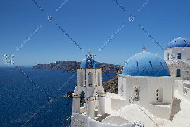 Blue Domed Churches On A Cliff Overlooking The Caldera; Oia, Santorini, Cyclades, Greek Islands, Greece