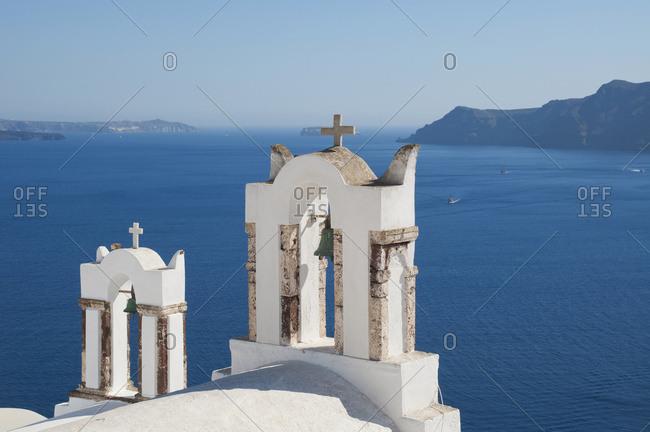 Church Bell Towers Overlooking The Caldera; Oia, Santorini, Cyclades, Greek Islands, Greece