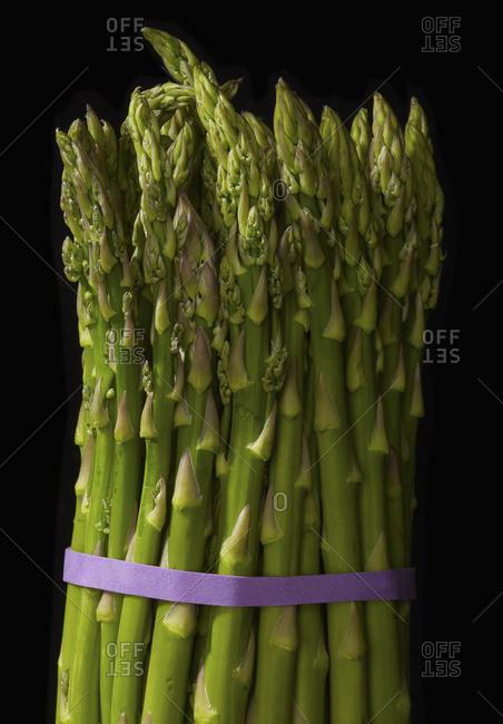 Asparagus Bundle On Black Background
