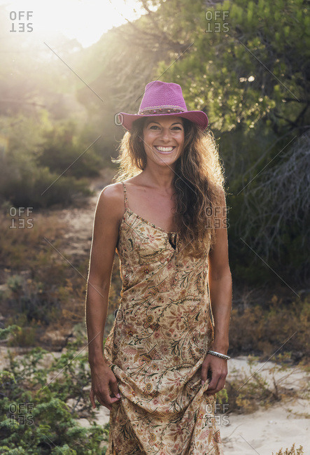 Portrait Of A Woman Wearing A Bright Pink Cowgirl Hat; Tarifa, Cadiz, Andalusia, Spain