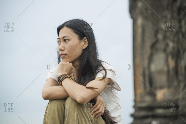 Portrait Of A Young Woman In Phnom Bakheng, Ancient Buddhist Temple From The Famous Angkor Area; Siem Reap, Cambodia
