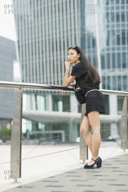 A Young Woman In The Business District; Xiamen, China