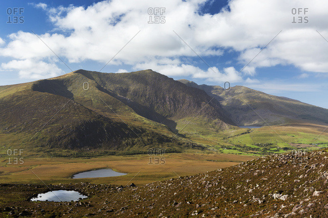 Large Mountain With Two Lakes With Clouds And Blue Sky; Dingle, County Kerry, Ireland