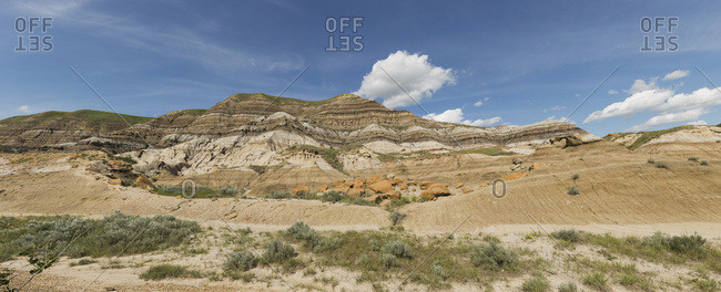 Panoramic View Of The Hillsides Around Drumheller, Alberta, With Layers Of Sedimentary Rock Creating Bands Of Color In The Landscape; Alberta, Canada