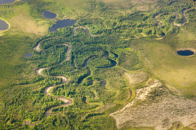 Aerial View Of Green Tundra And A Narrow, Winding Stream, Sand Dunes And Small Lakes, Arctic Alaska, Summer