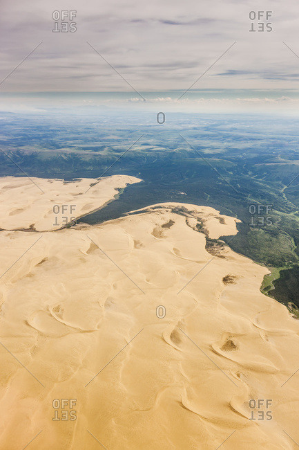 Aerial View Of The Great Kobuk Sand Dunes And Smoke From A Wild Fire In The Distance, Arctic Alaska, Summer