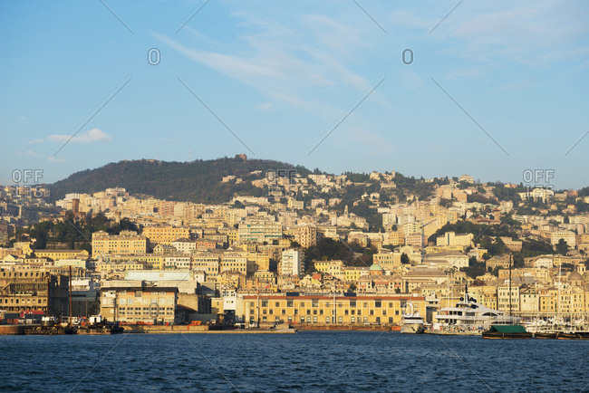 Boats In The Harbor And Buildings On The Waterfront; Genoa, Liguria, Italy
