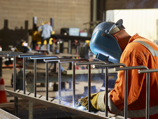 A Welder Wears A Visor And Welds In A Workshop; Edmonton, Alberta, Canada