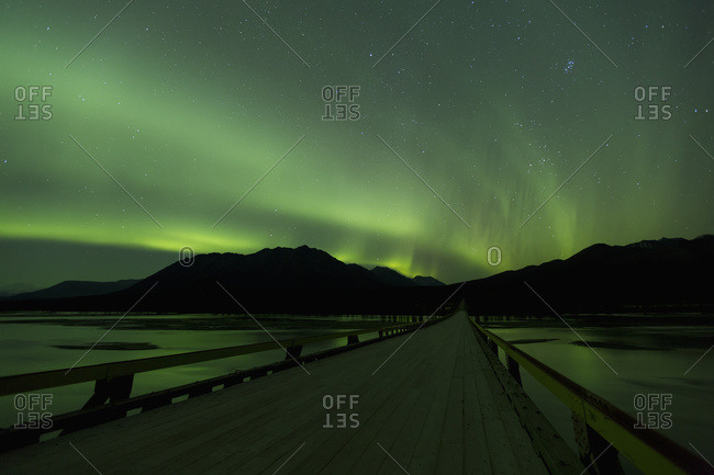 Aurora Borealis (Northern Lights) Dancing Above The Susitna River Bridge Along The Denali Highway, South-central Alaska; Alaska, United States Of America