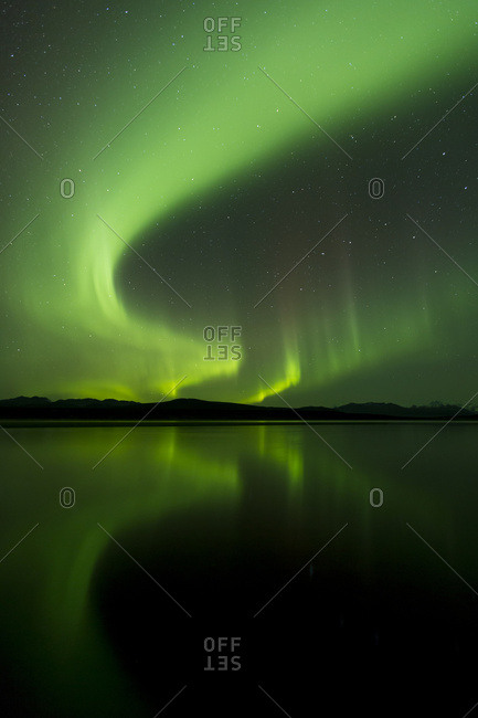 Aurora Borealis (Northern Lights) Reflected In 50 Mile Lake Along The Denali Highway, South-central Alaska; Alaska, United States Of America