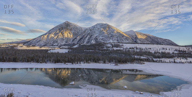 Late Winter Afternoon Light Warms Up The Mountains Along The Takhini River, Near Whitehorse; Yukon, Canada