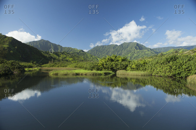 Reflections In The Calm Lumahai River And Valley, Near Hanalei; Kauai, Hawaii, United States Of America