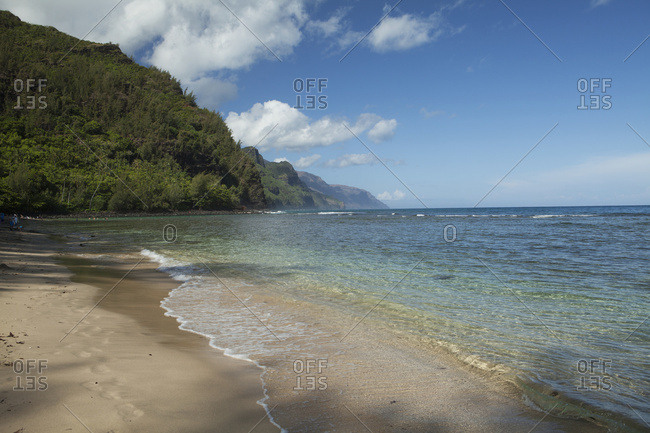 Kee Beach And Water At Haena Beach State Park, Na Pali Coast In Background; Kauai, Hawaii, United States Of America