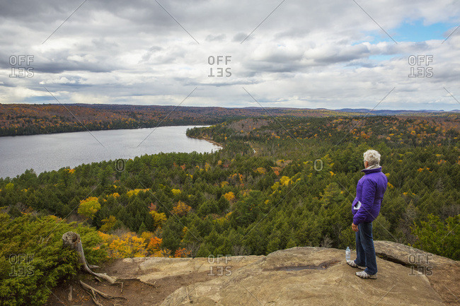 Woman Looking Out Over Rock Lake From Atop Booth's Rock, Algonquin Park; Ontario, Canada