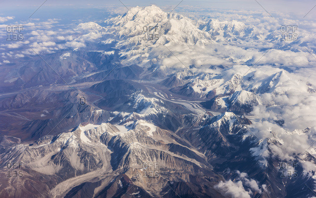 Aerial View Of Mount McKinley From The West, Lakes And Glaciers, Low Altitude Clouds In The Distance, Denali National Park; Alaska, United States Of America