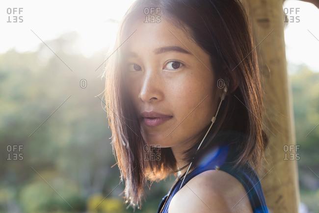 Portrait Of A Chinese Girl Listening To Music; Xiamen, Fujian Province, China