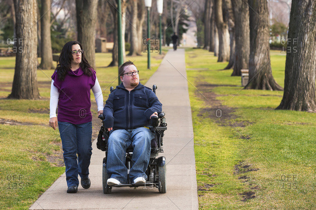 Disabled Husband Walking With His Wife In A Park In Autumn; Edmonton, Alberta, Canada