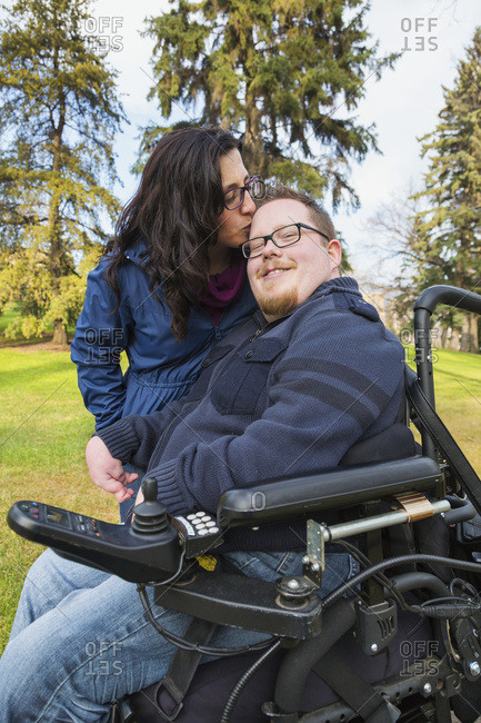 Disabled Husband With His Wife In A Park In Autumn; Edmonton, Alberta, Canada