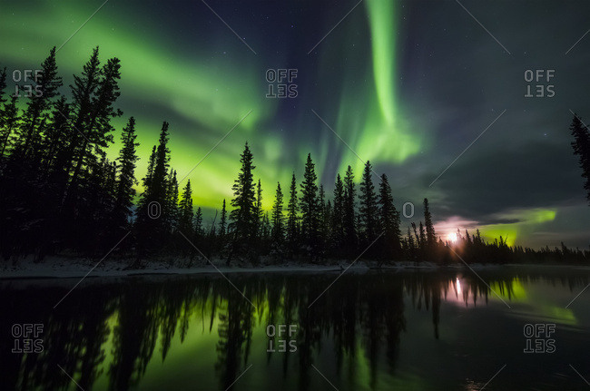The Aurora And Rising Moon Reflect In The Clearwater River In Delta Junction; Alaska, United States Of America