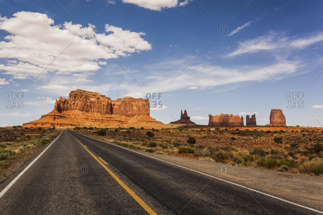 A Road Leading To Rugged Rock Formations In The Desert; Arizona, United States Of America