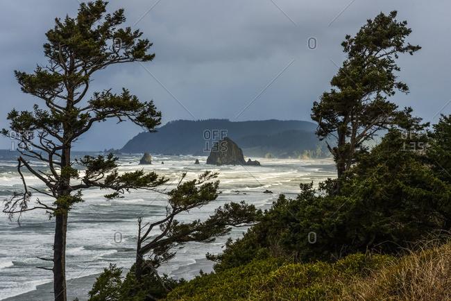 Sunlight Breaks Through The Storm On The Oregon Coast; Cannon Beach, Oregon, United States Of America
