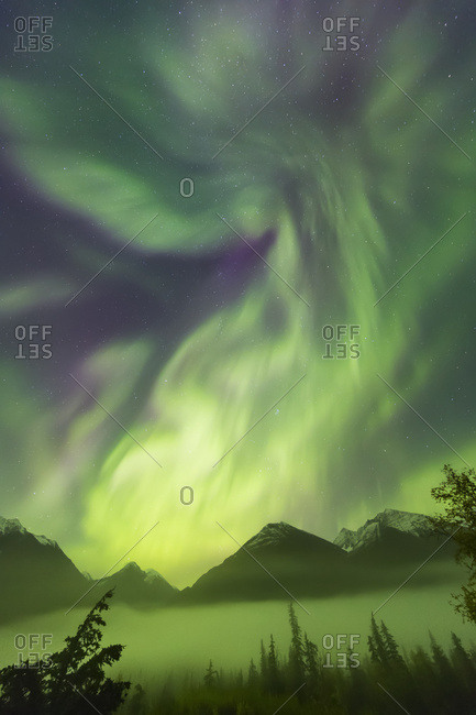 Bright Green Aurora Borealis Dances Over The Kenai Mountains, Moose Pass, Kenai Peninsula, South-Central Alaska; Alaska, United States Of America