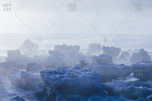 Sea Ice Is Shrouded In Fog Along Turnagain Arm In Winter, South-Central Alaska; Alaska, United States Of America