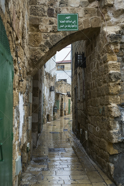 A Narrow Walkway Lined With Stone Walls; Israel