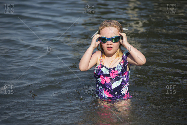 A 5-Year-Old Caucasian Girl With Blond Hair Swims In Seneca Lake In Upstate New York; Dresden, New York, United States Of America