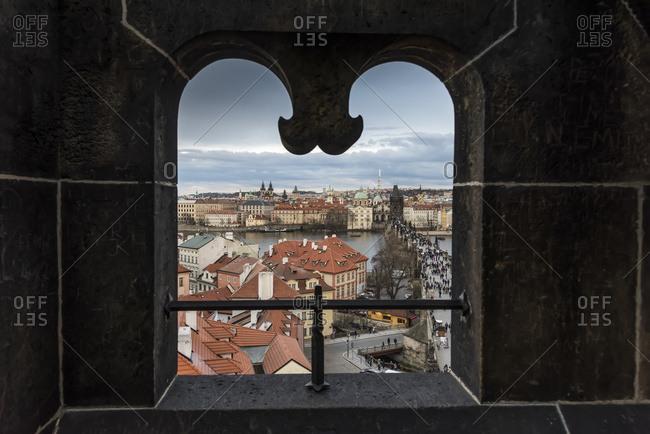 View Of The City Of Prague Framed Through A Uniquely Shaped Window; Prague, Czechia
