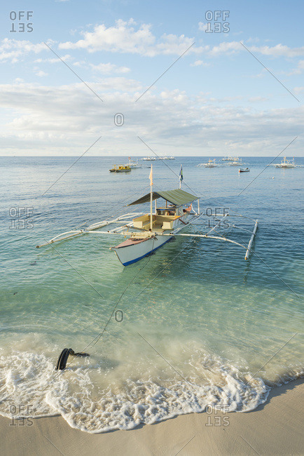 September 1, 2013: Boats On The Crystal Waters Of Alona Beach; Panglao Island, Bohol, Philippines