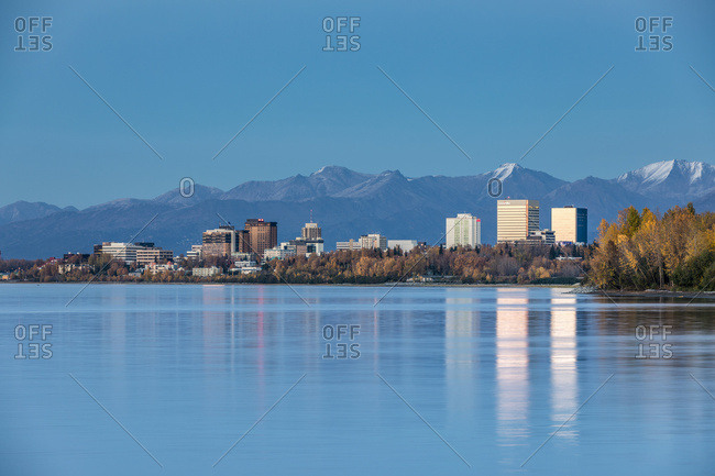 September 29, 2016: The Setting Sun Reflects Off Of Office Buildings In Downtown Anchorage, Seen From Earthquake Park, The Chugach Mountains In The Background, South-Central Alaska; Anchorage, Alaska, United States Of America