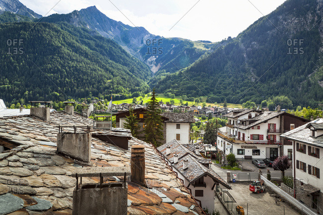 July 13, 2014: Historic stone roofs of buildings, viewed from city center of Courmayeur; Courmayeur, Aosta Valley, Italy