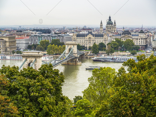 December 1, 2017: Boats on the Danube River and cityscape of Budapest; Budapest, Budapest, Hungary
