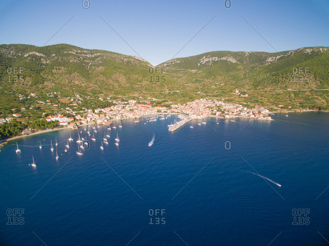 Aerial view of boats docked in marina on Vis Island in Komiza town, Croatia.