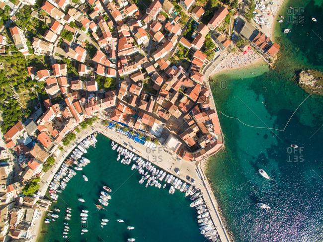 Aerial view of Komiza town and boats docked in marina on Vis Island, Croatia.