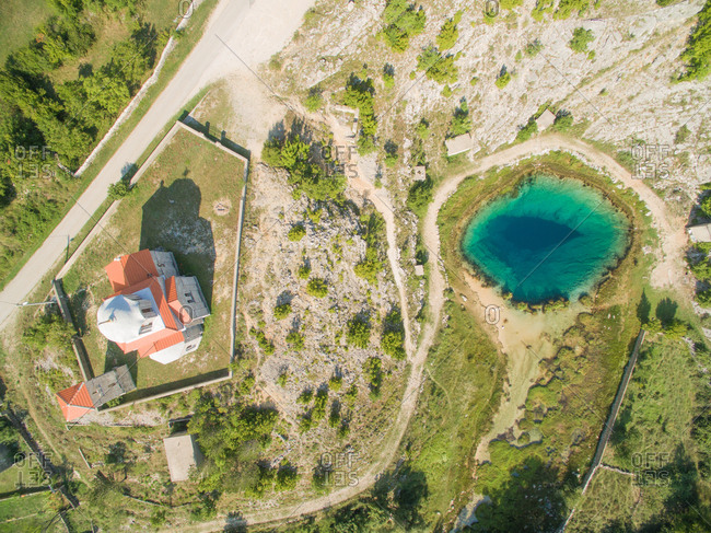 Aerial view of the Glavas source of the Cetina river and Orthodox Church, Croatia.
