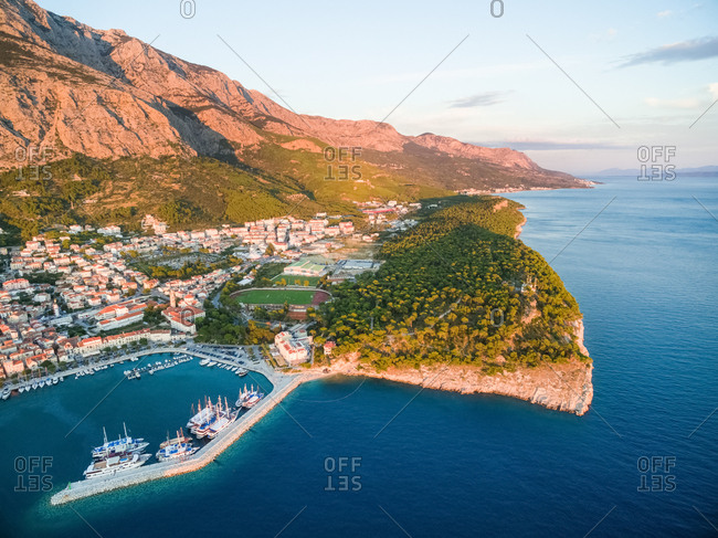 Aerial view on Makarska at sunset with Biokovo mountain in background (Croatia).
