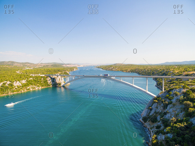 Aerial view of cars and bus driving over Sibenik bridge, Croatia.
