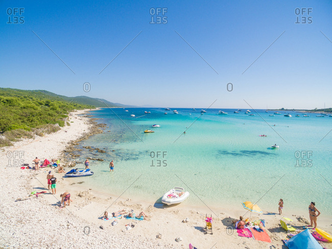 ADRIATIC COAST - 27 AUGUST 2014: Aerial view of sandy beach with tourists swimming in beautiful clear sea water