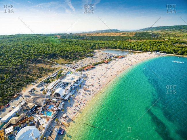 PAG, CROATIA - AUGUST 30, 2014: Aerial view of beach and clubs at popular Zrce beach