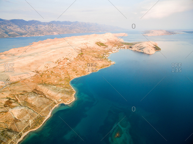 Aerial view of island of Pag with place Zubovici in distance, Croatia.