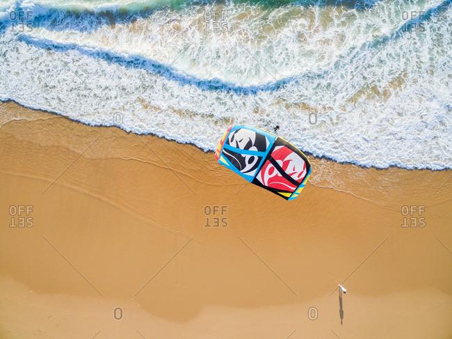 PRAIA DA GUINCHO BEACH, PORTUGAL - MAY 23, 2017: People kite surfing at popular blue flag Guincho beach.