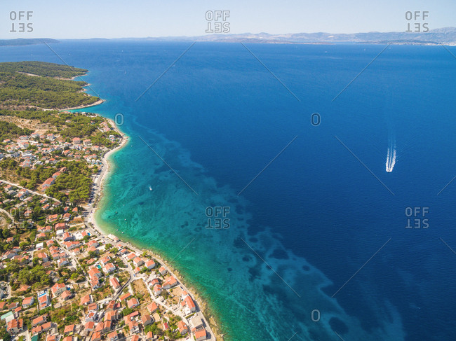 Aerial view of small harbor with moored boats in the Adriatic
